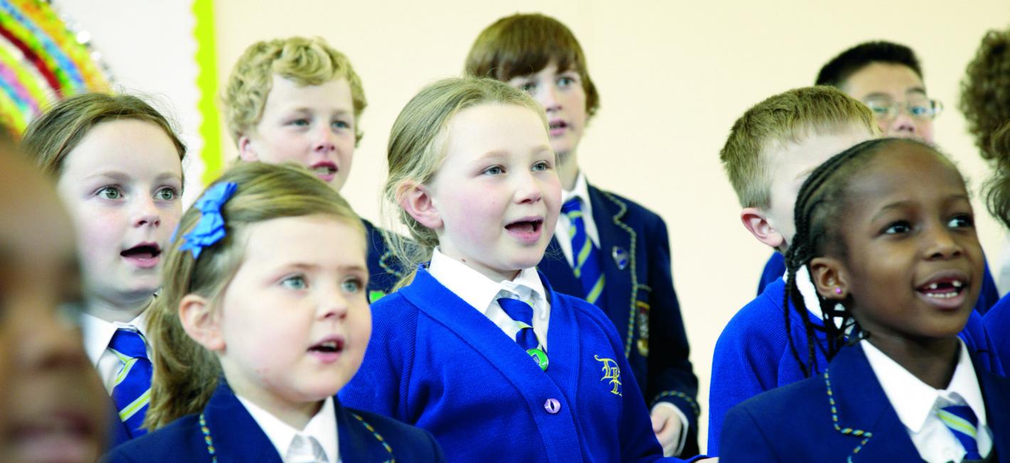 children singing in a group in Dudley School Gra