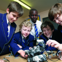 Group of Year 6 boys building a programmable robot with Lego