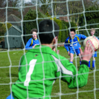 Goal keeper at Dudley House School reaching out to stop ball going in the goal