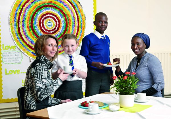 Pupils serving a Mother's day tea