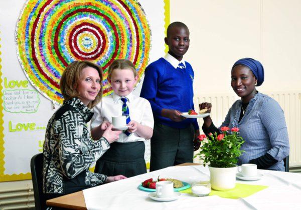 Pupils serving a Mother's day tea