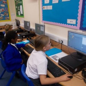 Children working on computer creating animations with Scratch